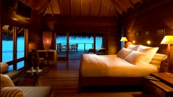 Sweeping views of the Indian Ocean from the comfort of your bed in the Water Villas
