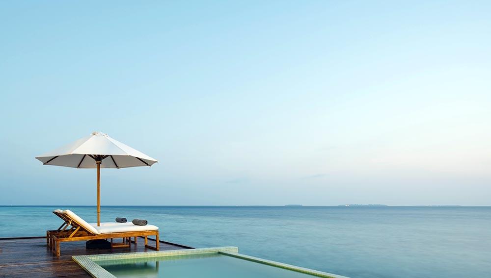 Sunset Water Pool Villa at Noku Maldives Resort